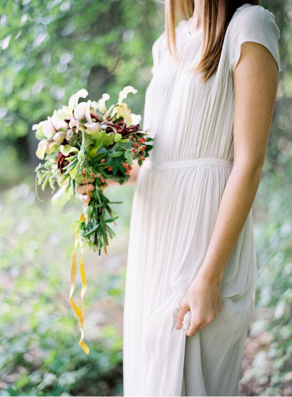 Bohemian inspired wedding dress at altar