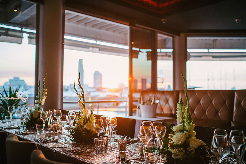 Table set for a wedding reception at Glass Dining & Lounge Bar with a view of the Gold Coast city skyline.