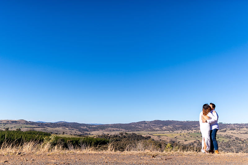 Bride and Groom together under a beautiful blue sky and country surrounds.