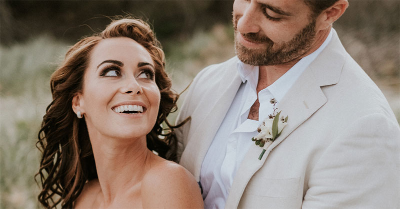 Bride smiling at Groom with beautiful white teeth.