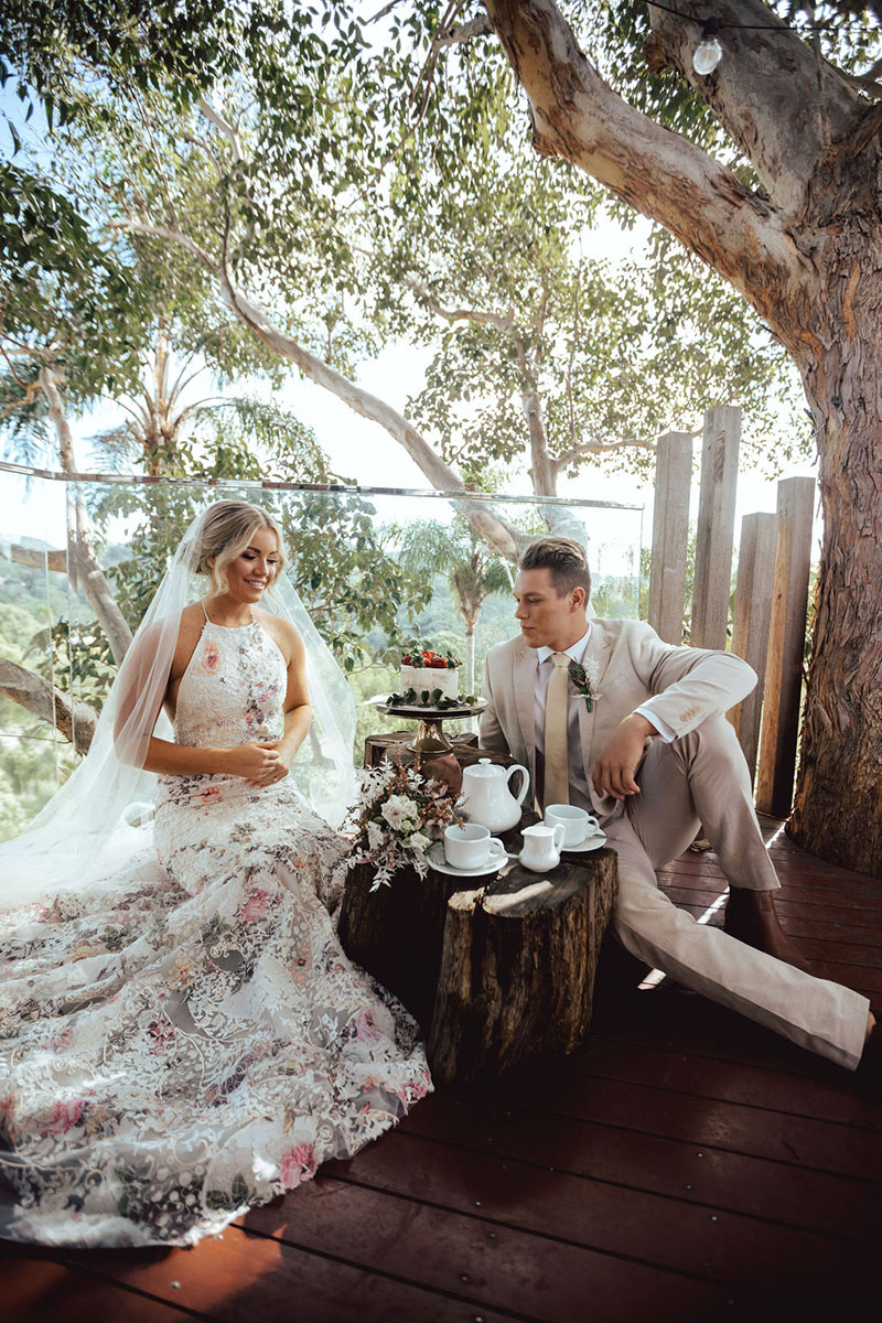 Photo by DK and Co. Photography of Bride and Groom having a tea party in treehouse.