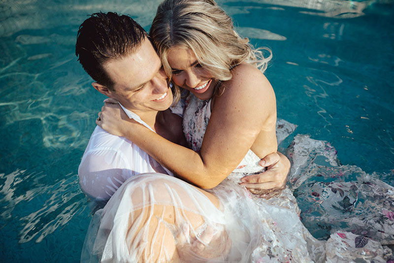 Photo by DK and Co. Photography of Bride and Groom in pool.