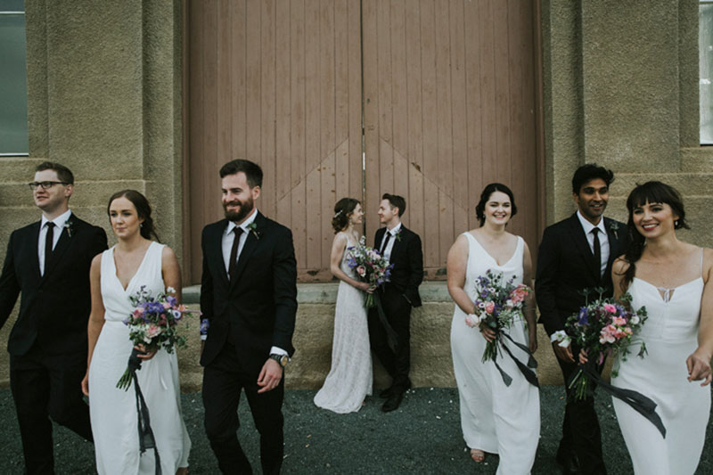 Fusing of traditional and candid style photo of couple and their wedding party.