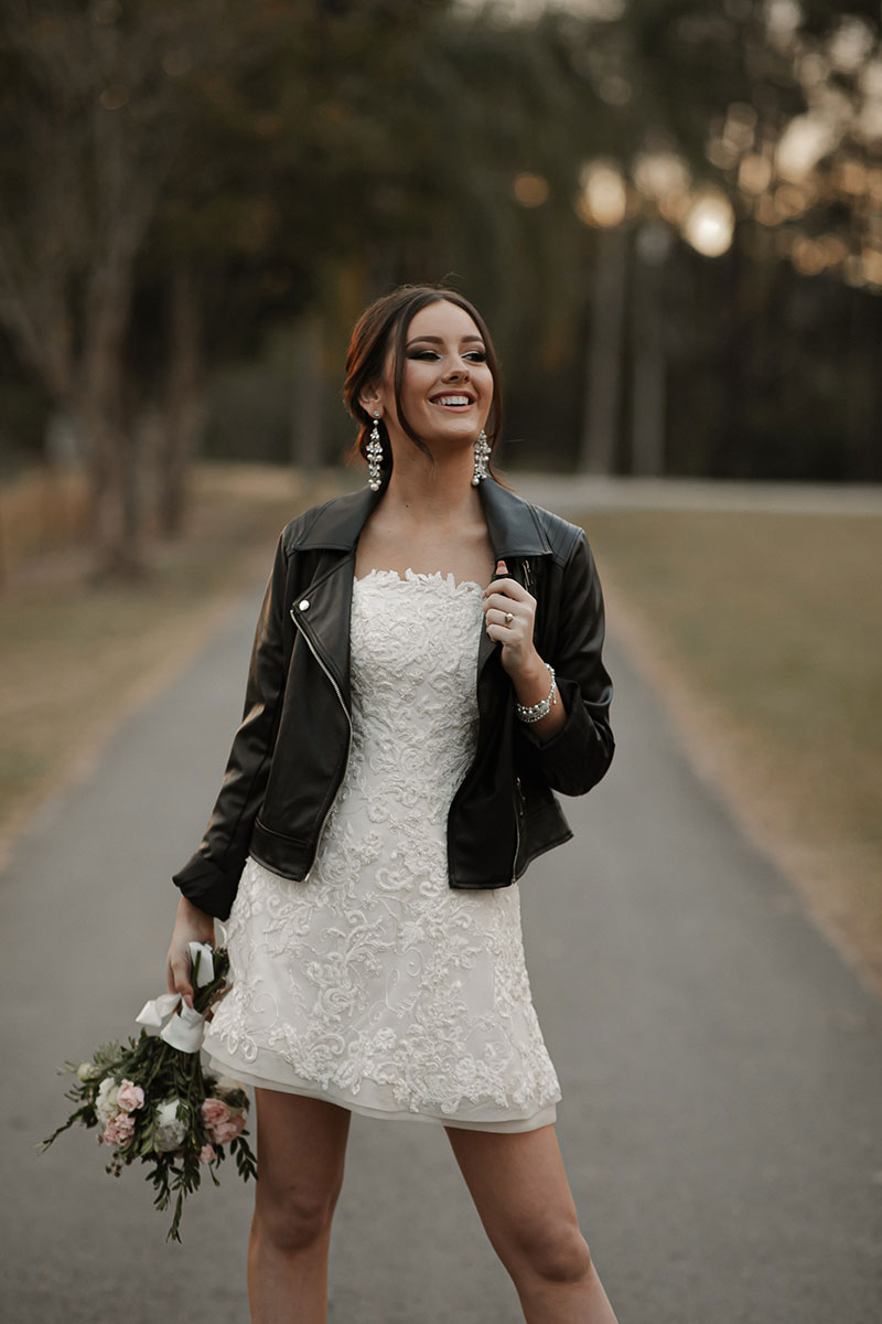 Photo by Tom Judson Photography of model wearing party dress without organza underskirt, and a black leather jacket.