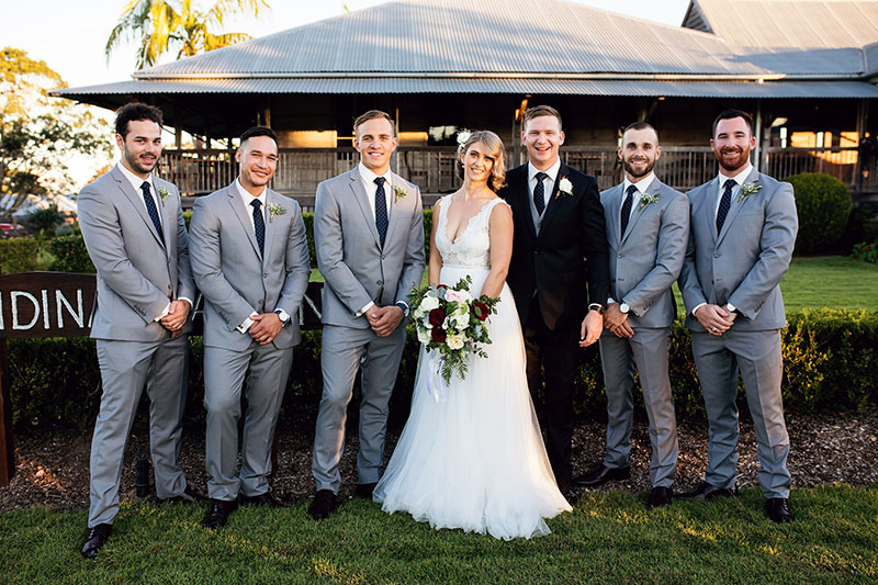 Groom with his Bride and Groomsmen.