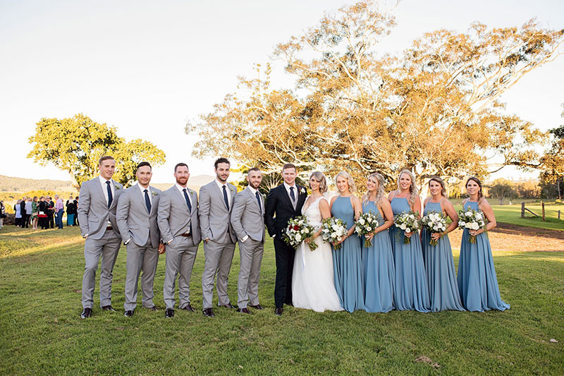 Country themed wedding with the Groomsmen in light grey and Bridesmaids in blue.
