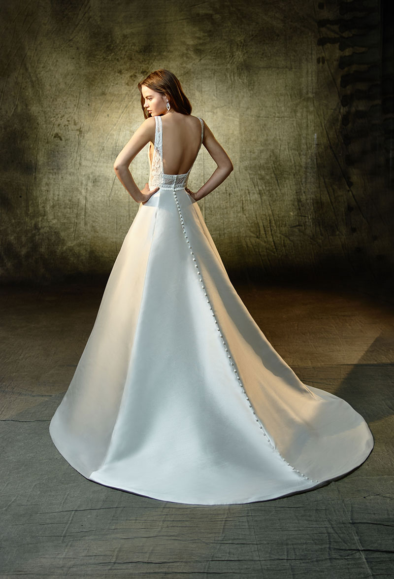 Back view of a gorgeous flowing wedding gown from the Enzoani Collection.