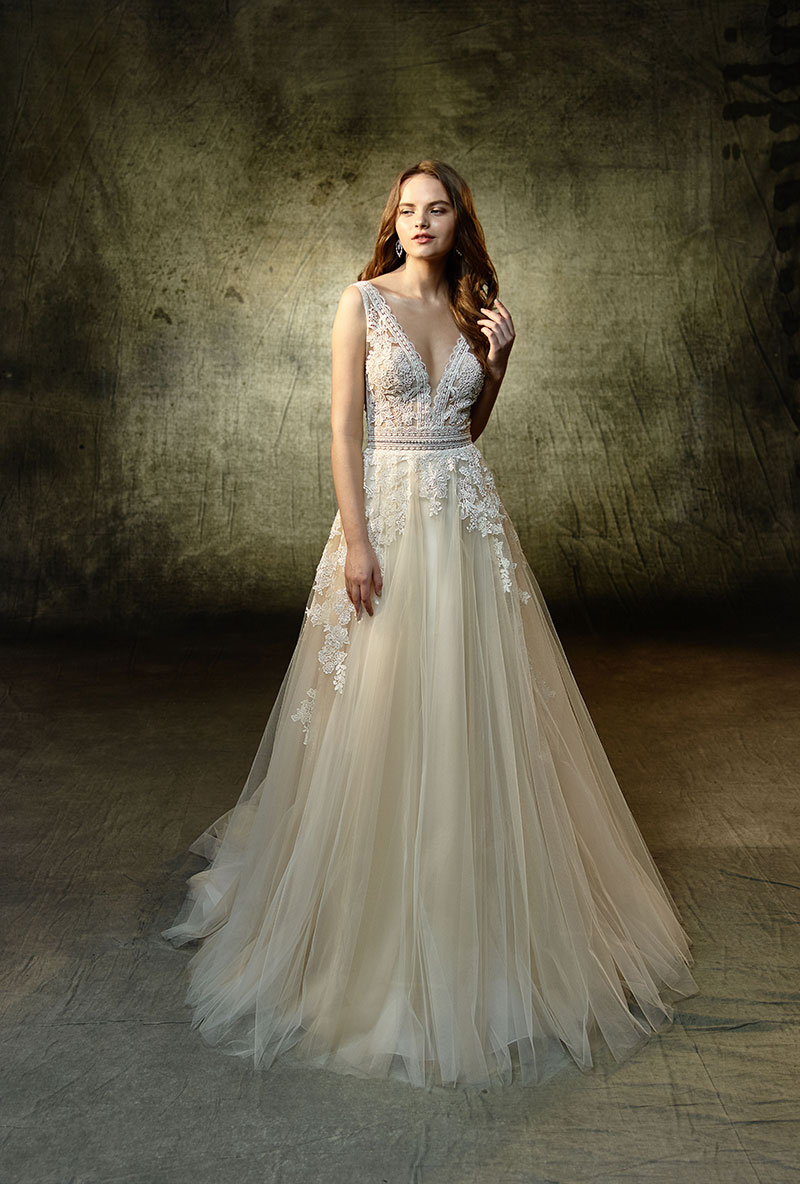 Bride wearing a wedding gown with a lace bodice and soft, flowing skirt from the Enzoani Collection.
