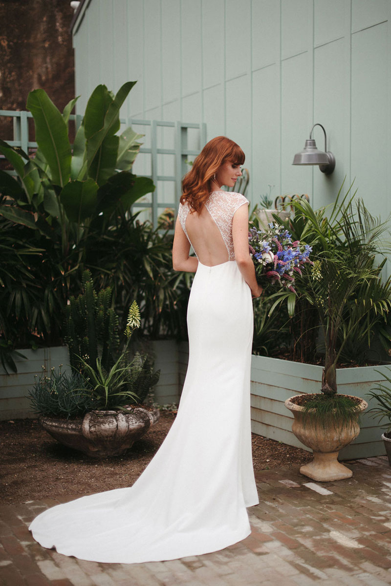 Bride wearing a gown with a cut-out back.
