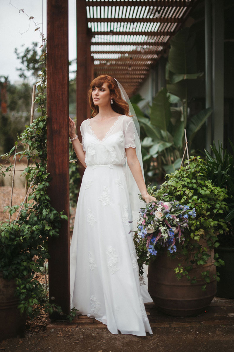 Bride wearing flowing Magnolia gown, from French by Wendy Makin.