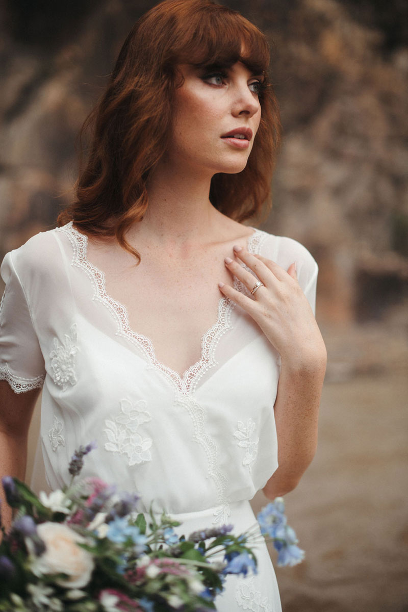 Bride wearing a delicate lace gown, Magnolia from French by Wendy Makin.
