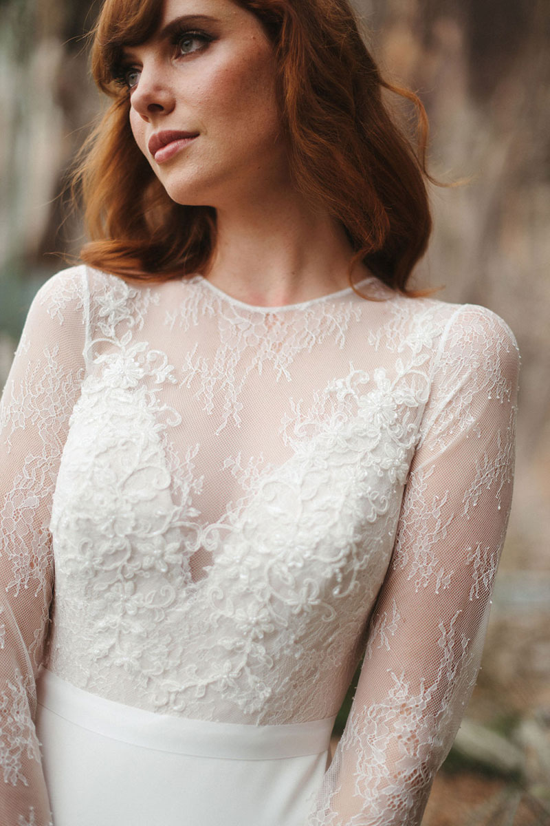Close up of an embroidered lace bodice of a wedding dress.