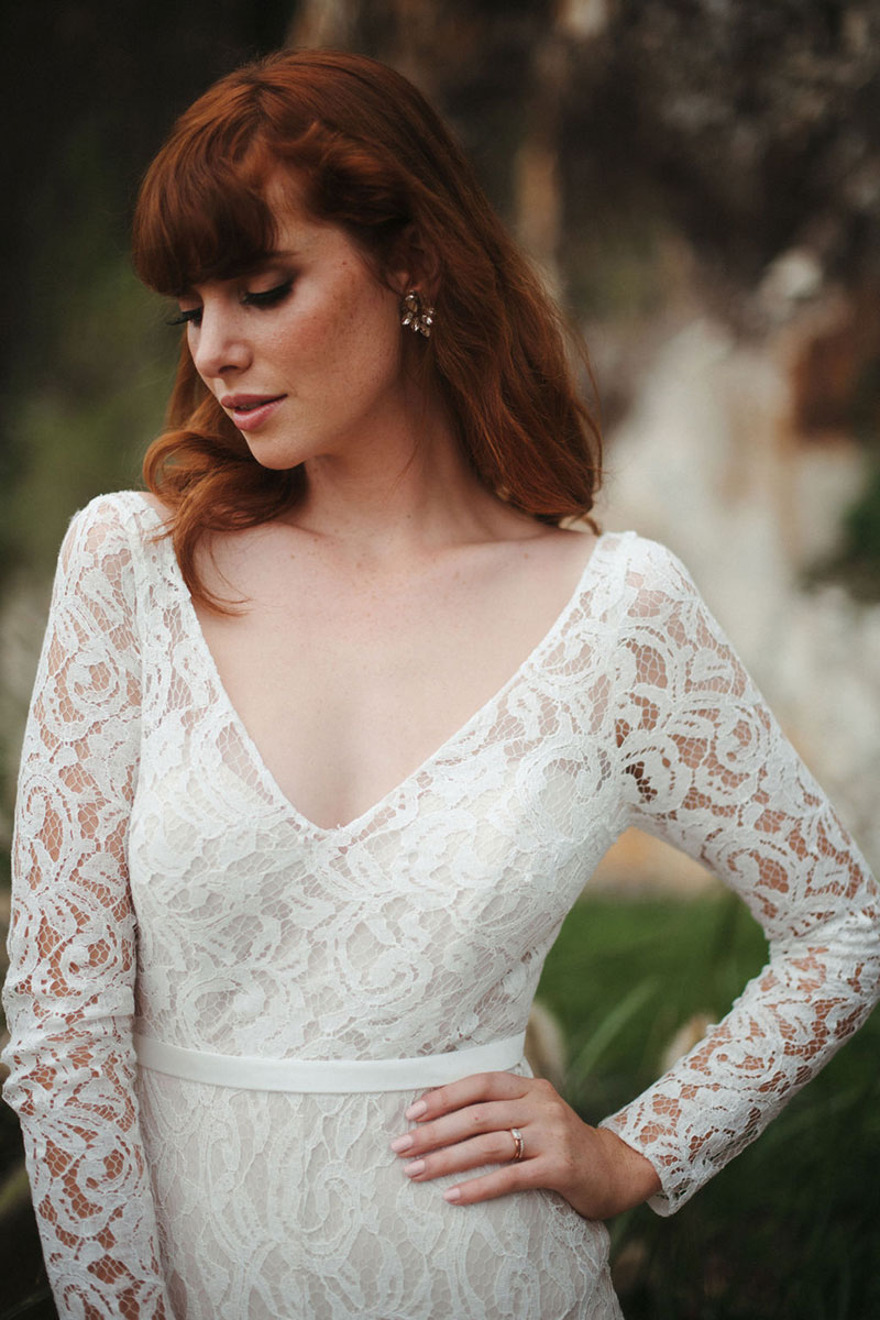 Close up of an allover lace wedding dress.