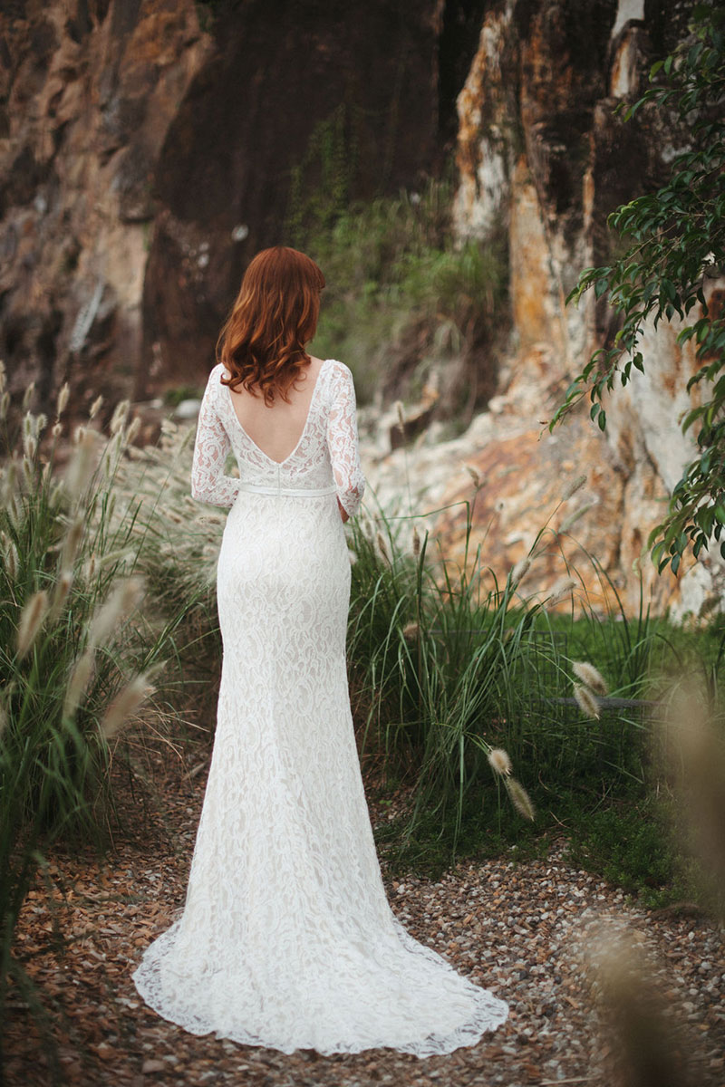 Back view of an allover lace gown.