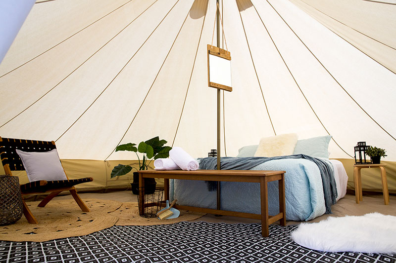 Inside a spacious and luxurious Bell tent from Glamping Days Hire Co.