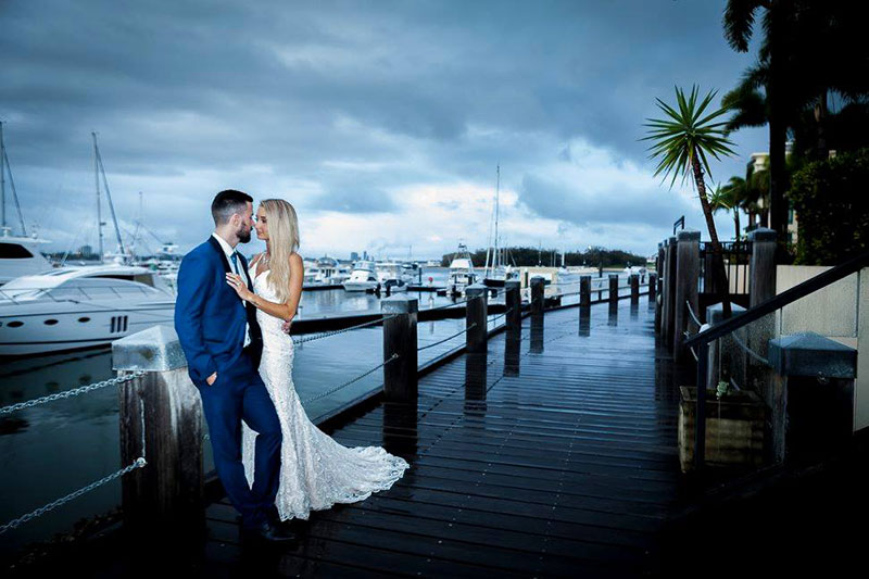 Bride and Groom enjoying the Marina views at Glass Dining & Lounge Bar