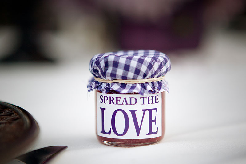 Jar of homemade jam with the message 'spread the love' written on it.