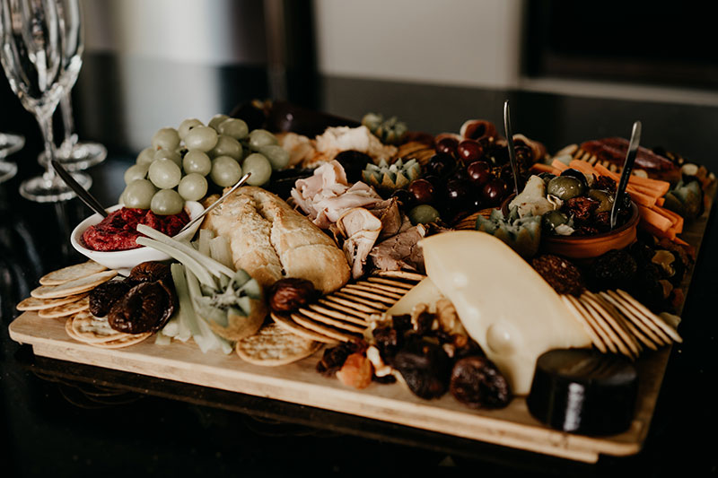 Lots of cheese, olives and dried fruit on this grazing platter.