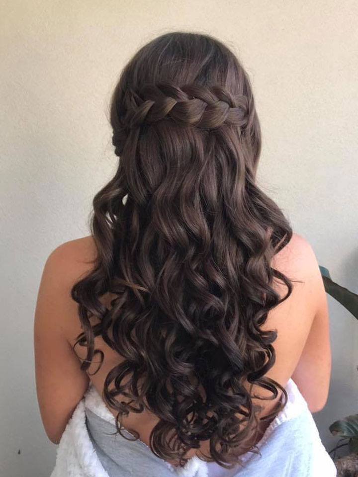 Long dark haired bride-to-be with romantic curls and braid