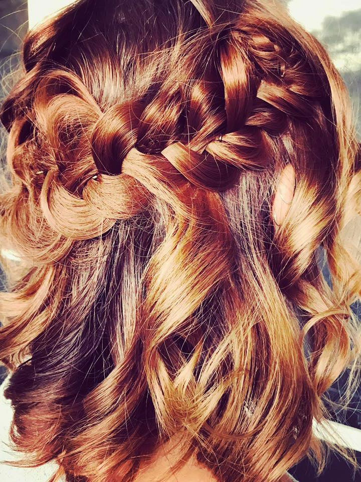 light coloured hair which has been curled and braided on a bride-to-be.
