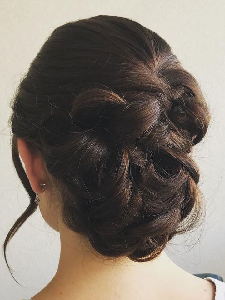 upstyle with braids on a dark haired bride-to-be.