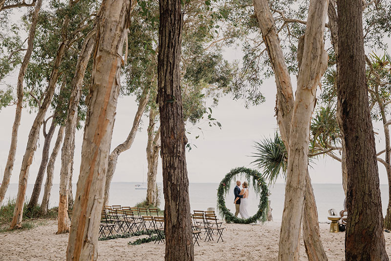 Getting married on the beach at Kingfisher Bay Resort.