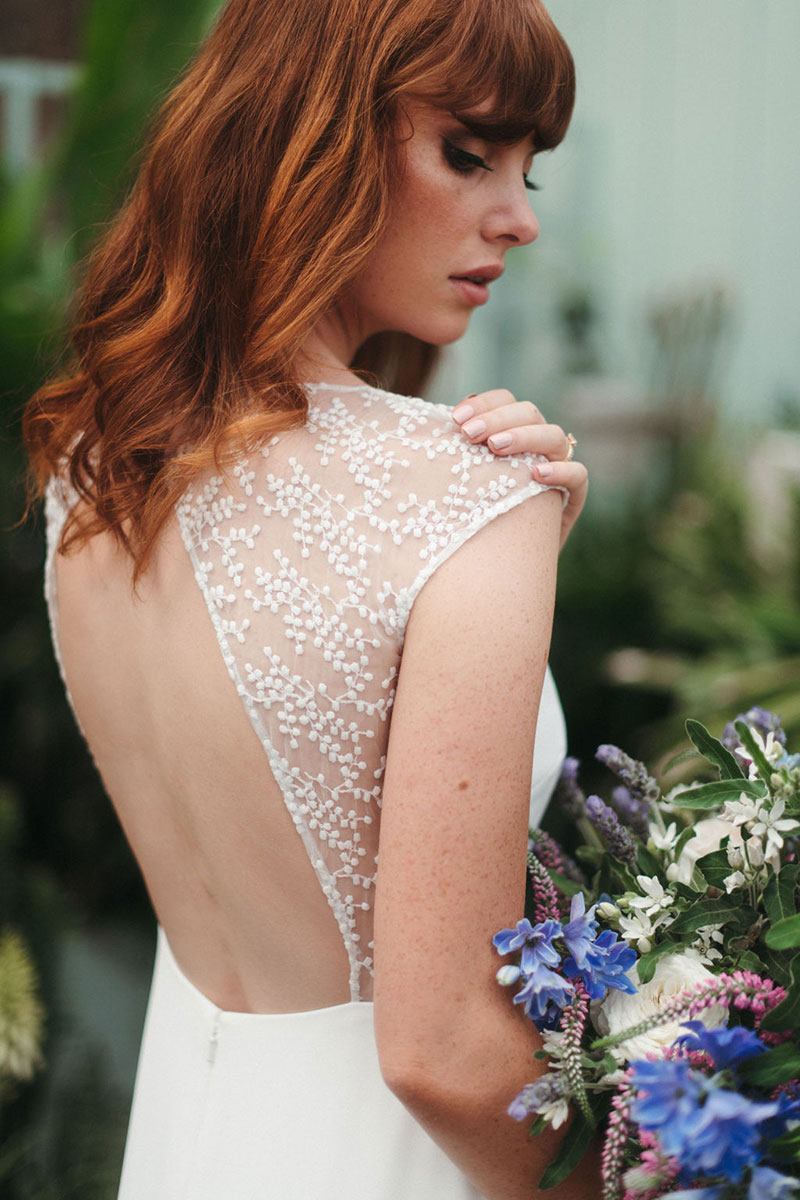 Bride wearing a gorgeous open back wedding gown called 'Lavande' from French by Wendy Makin.