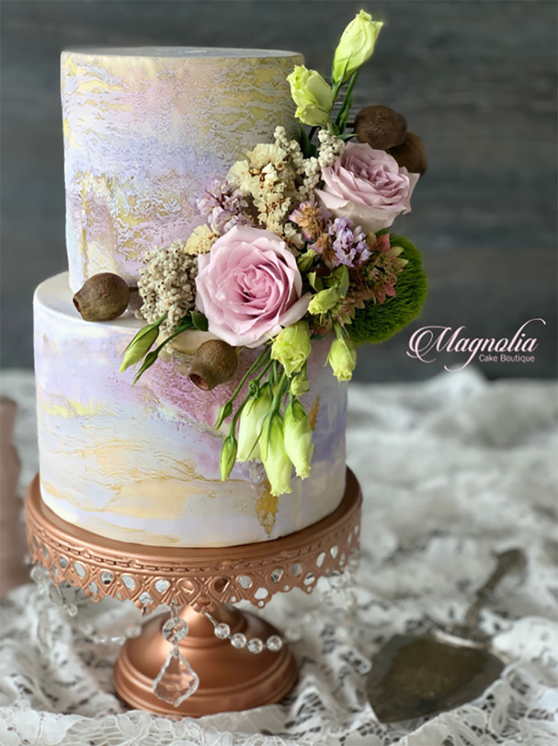 Marbled effect wedding cake with florals.