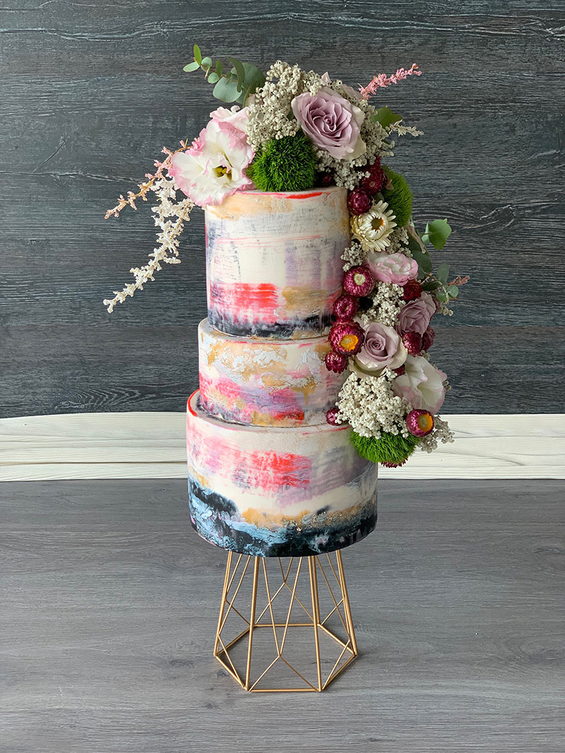 Colourful Hand painted wedding cake with florals.