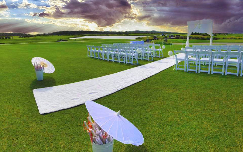 Wedding Ceremony set up with white chairs and white runner at Maroochy River Golf Club.