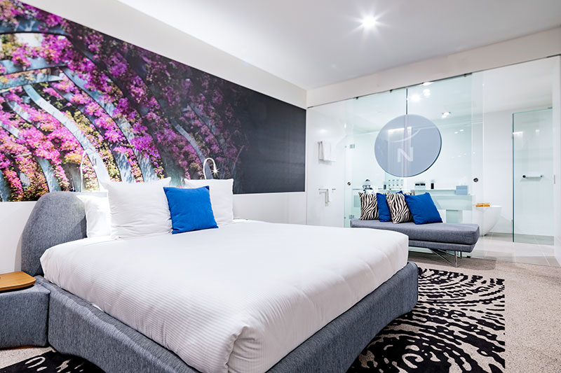 Stylish, spacious King sized bed and suite at Novotel Brisbane South Bank.