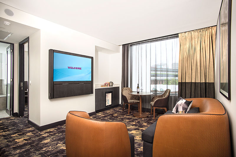 Lounge area of an Executive King Suite at Rydges Fortitude Valley.
