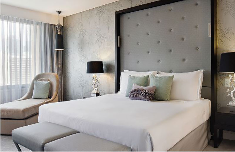 Luxurious Junior Suite in silver and mint hues at Sofitel Brisbane Central.