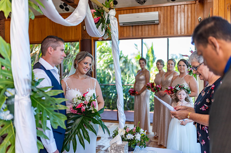 Happy bride and groom getting married in ceremony in Fiji.