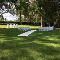 Outside wedding ceremony on the lawn at Highfields Cultural Centre