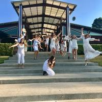 Hens jumping on steps for food and wine tour
