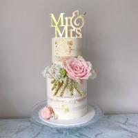Rustic wedding cake with pink florals by Sweetcakes Co.