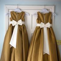 Dresses hanging on a door