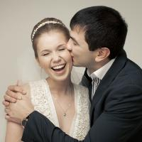 Young newlyweds kissing