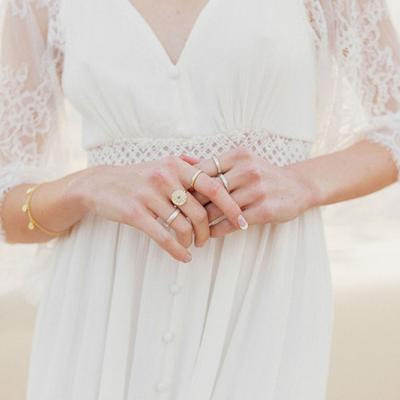Beautiful variety of rings worn by bride.