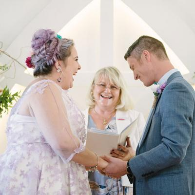 Annette Richards Celebrant laughing with happy Bride and Groom at their wedding ceremony.