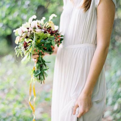 Bohemian inspired wedding dress at altar