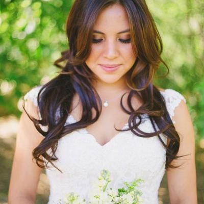 Bride holding bridal bouquet of yellow and white flowers